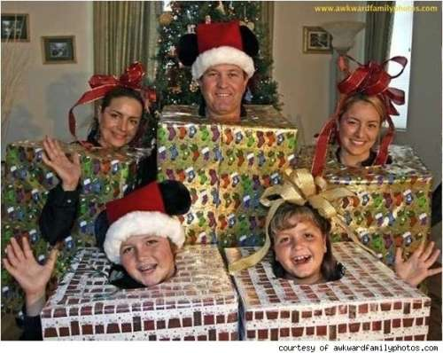 family dressed as christmas presents