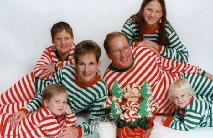 family in striped sweaters christmas photo