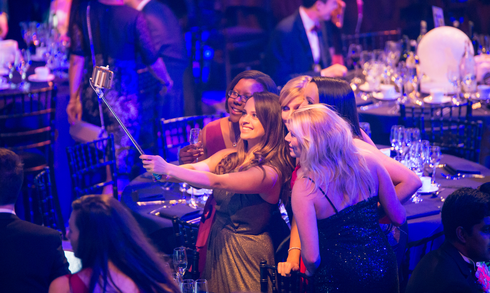 people taking a selfie - london christmas party