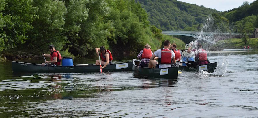 corporate groups canoeing on the River Wye