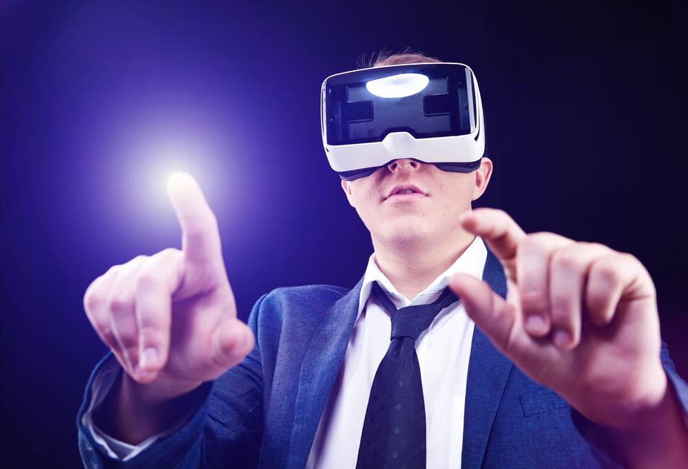 Businessman has fun using his Virtual Realitiy VR glasses - fundraising events